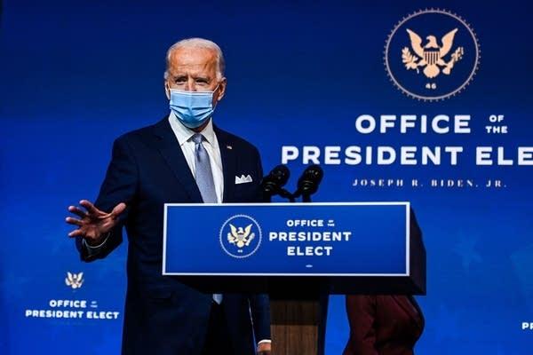 President-elect Joe Biden speaks during a cabinet announcement event.