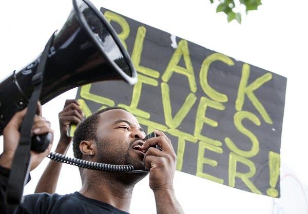 Organizer Rashad Turner lead a chant.