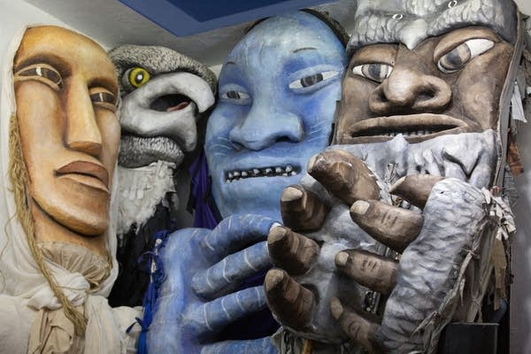 Large-scale puppets represent the sky, woods, prairie and river.