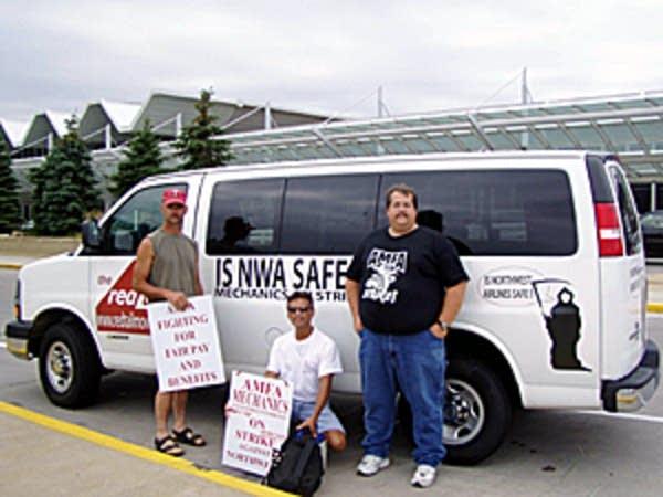 AMFA strikers and their van