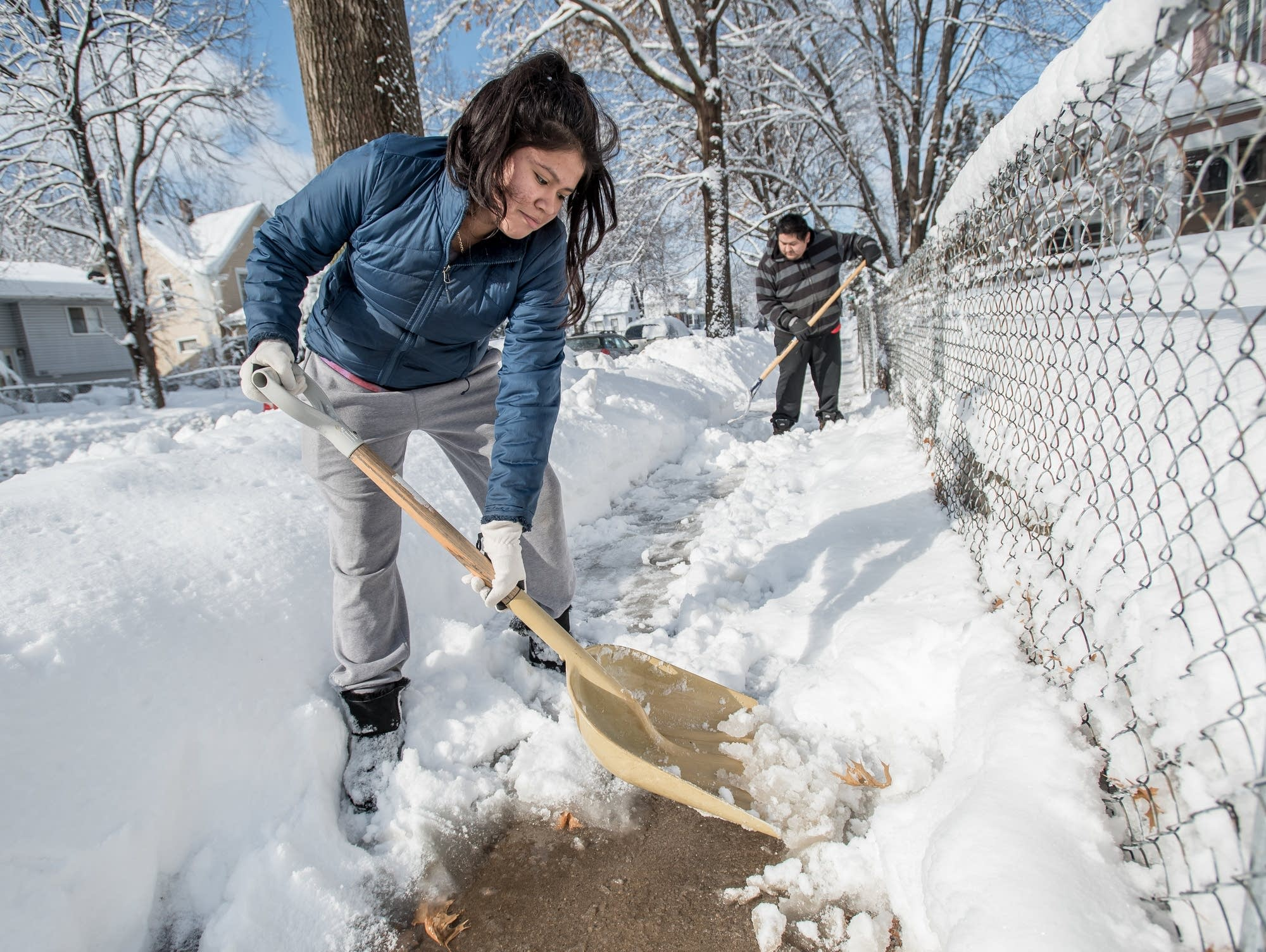 Joanna Peralta, 14, and her father Reme Peralta, 35, shovel the snow