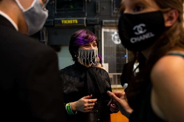 Students smile while wearing masks.
