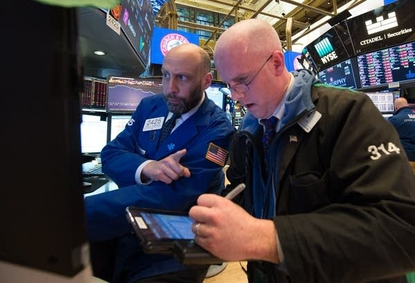 Traders work on the floor at the New York Stock Exchange.