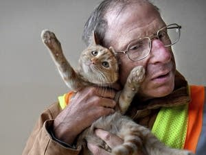Chuck Nehls cuddles with his new kitten.