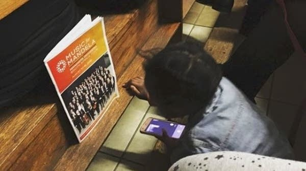 A pint-sized attendee at the Minnesota Orchestra's performance in Soweto.