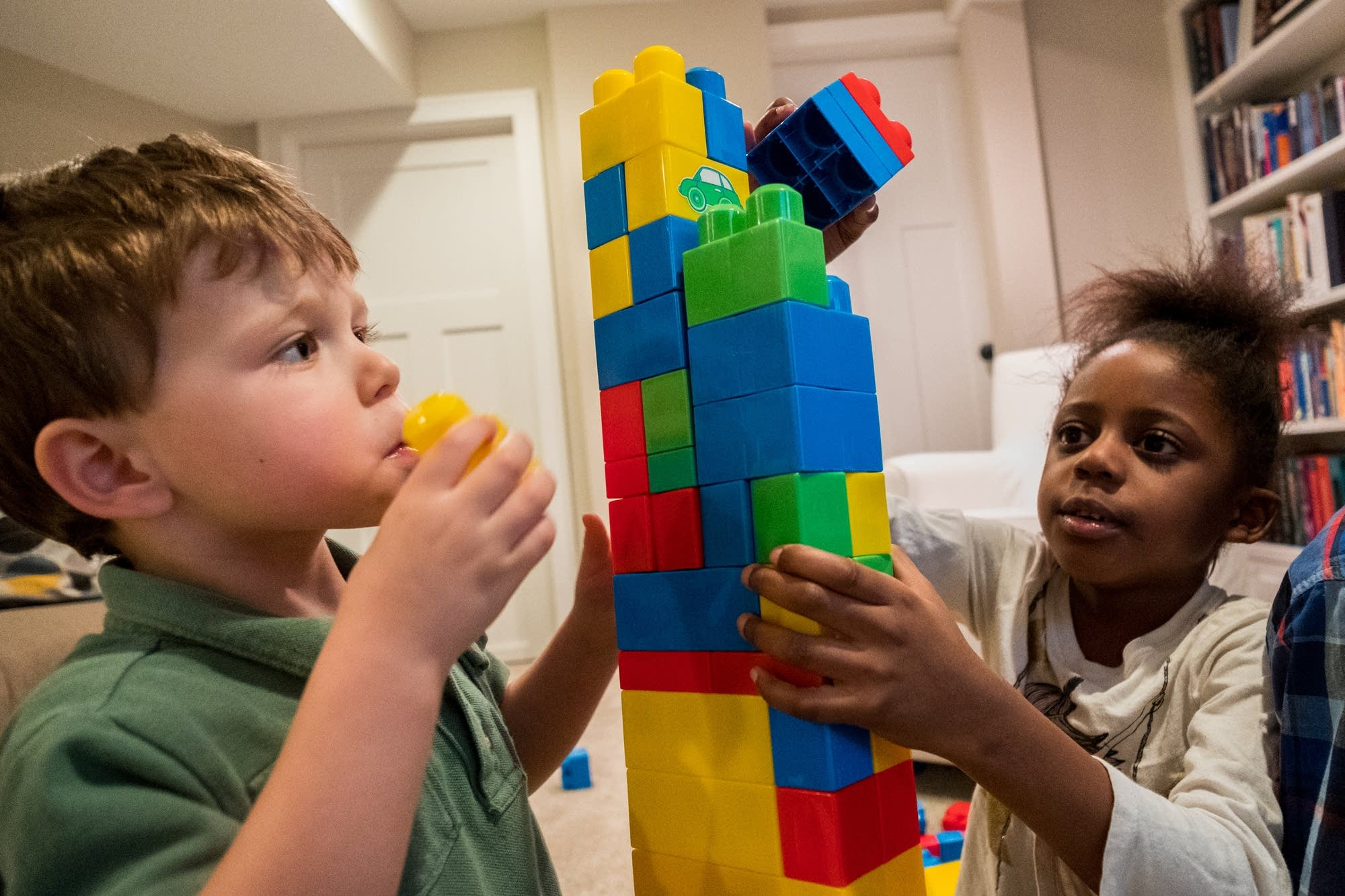 Luca Choudry and Esther Mphiri build a block tower together.