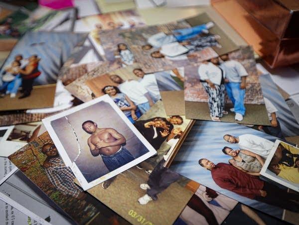 Numerous photos on a table.
