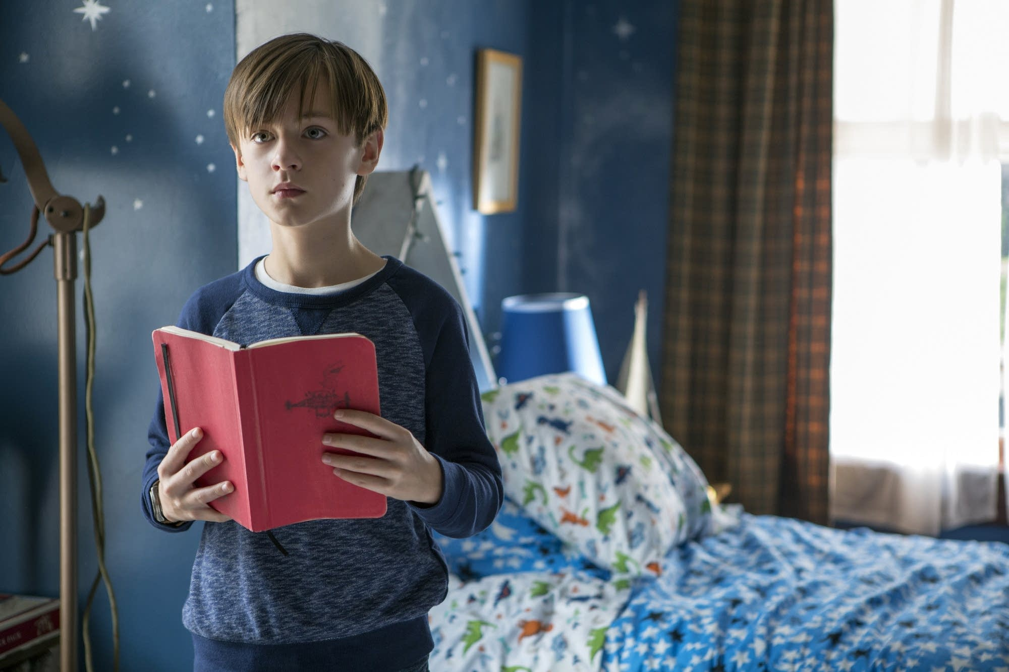 Jaeden Lieberher as Henry, a precocious 11-year-old