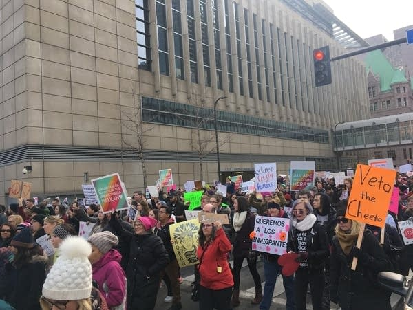 Demonstrators march in support of immigrant and refugee rights.
