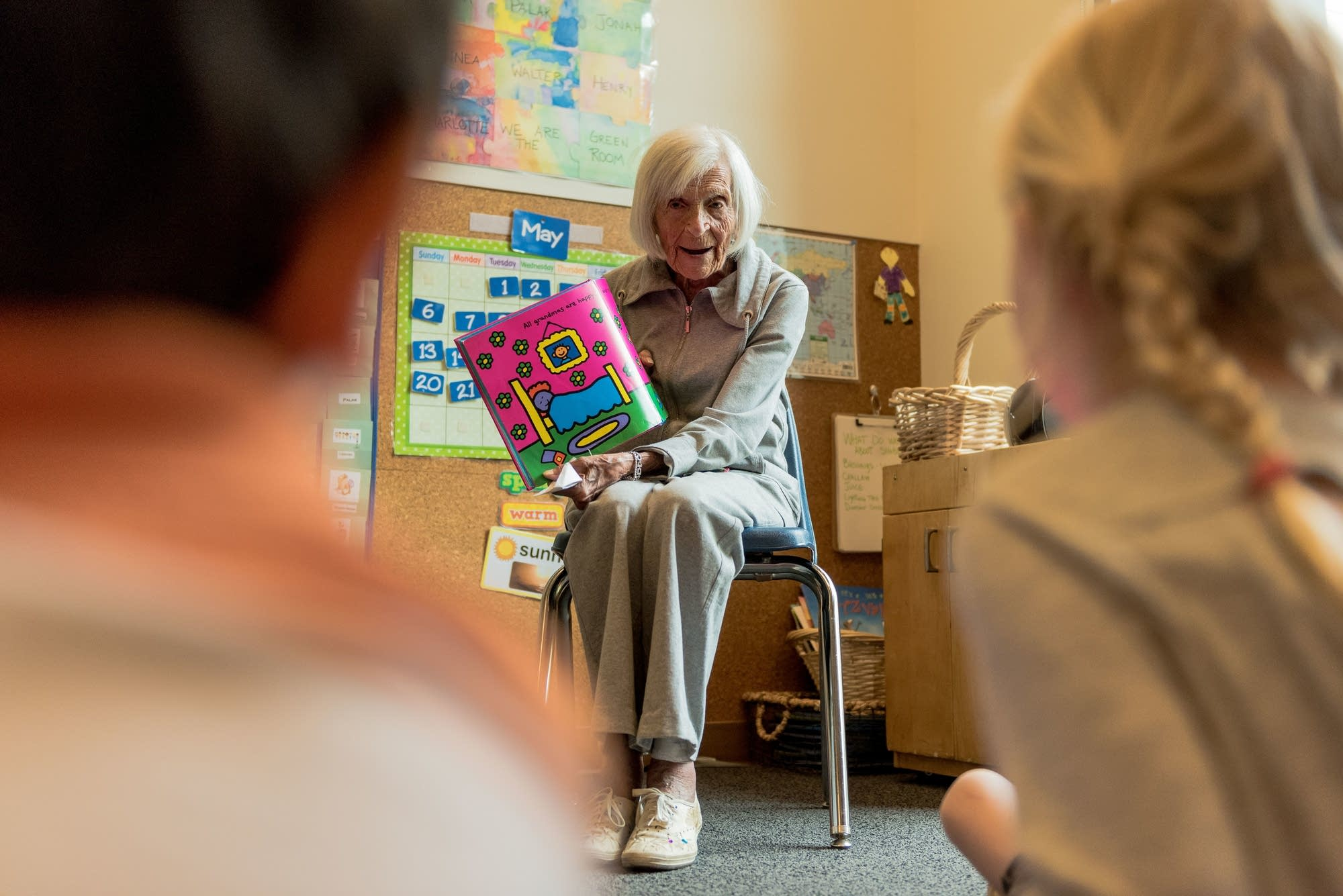 Ruth Knelman reads 'The Grandma Book' by Todd Parr to pre-k students.