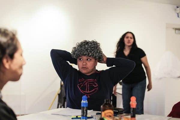 Vanessa Goodthunder tries on her wig, as she plays the grandmother.