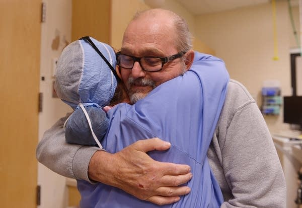 Steve Froemel meets and hugs team