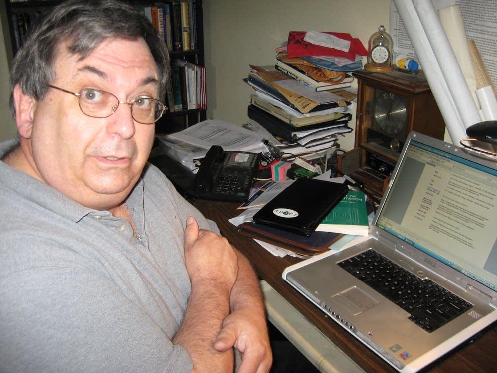 Steve Cross works on resume