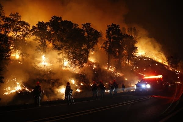 Backfire set to stop fast-moving wildfire