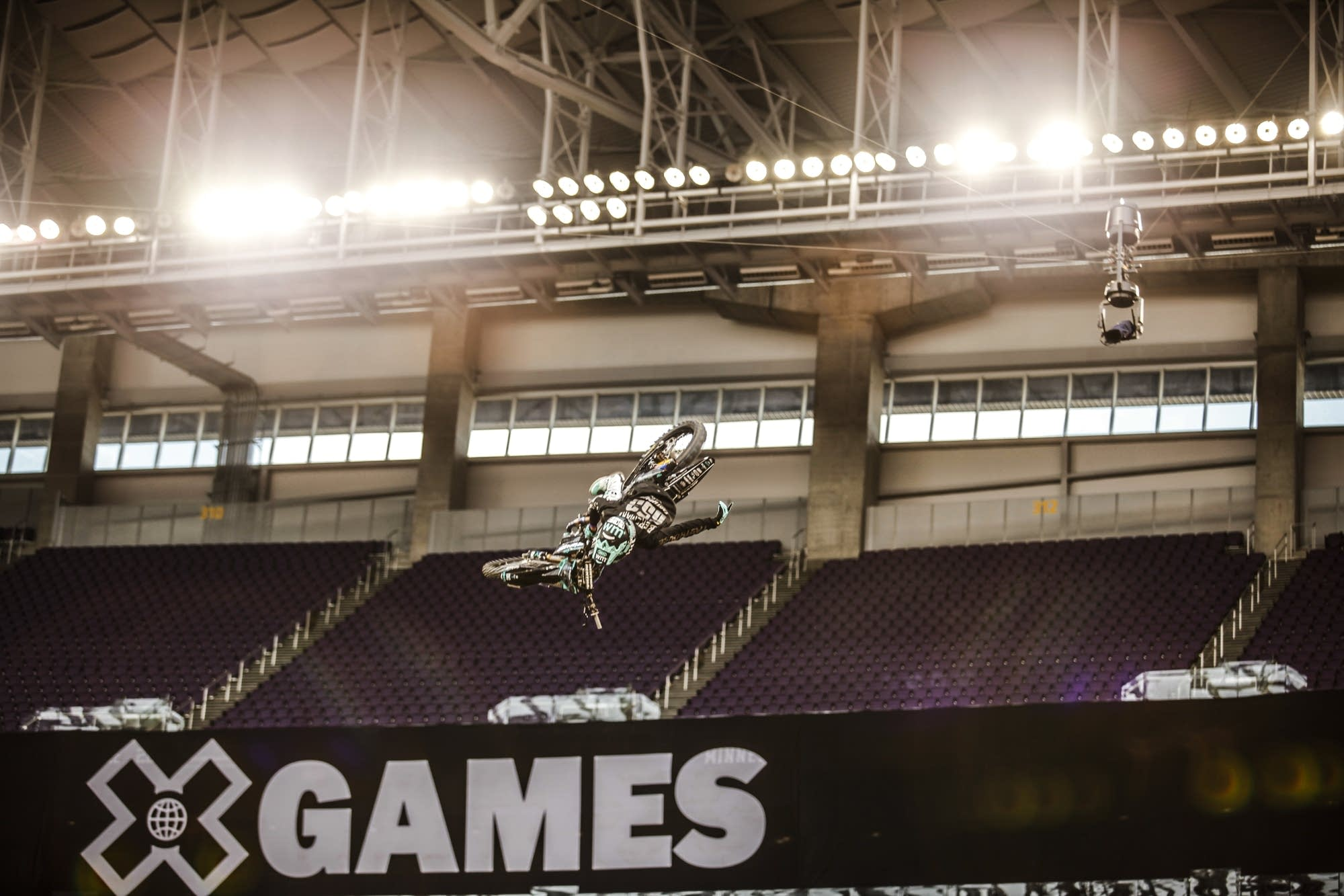 California native Tyler Bereman jumps a height of about 25 feet.