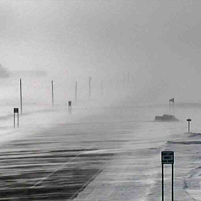 Blizzard conditions can be seen along a stretch of State Highway 19