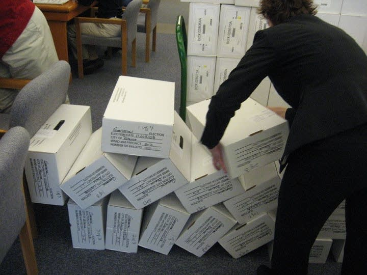 Boxes of ballots knocked over