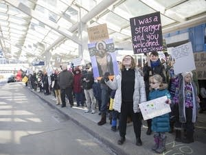 Protesters line the sidewalk outside the upper level of MSP.