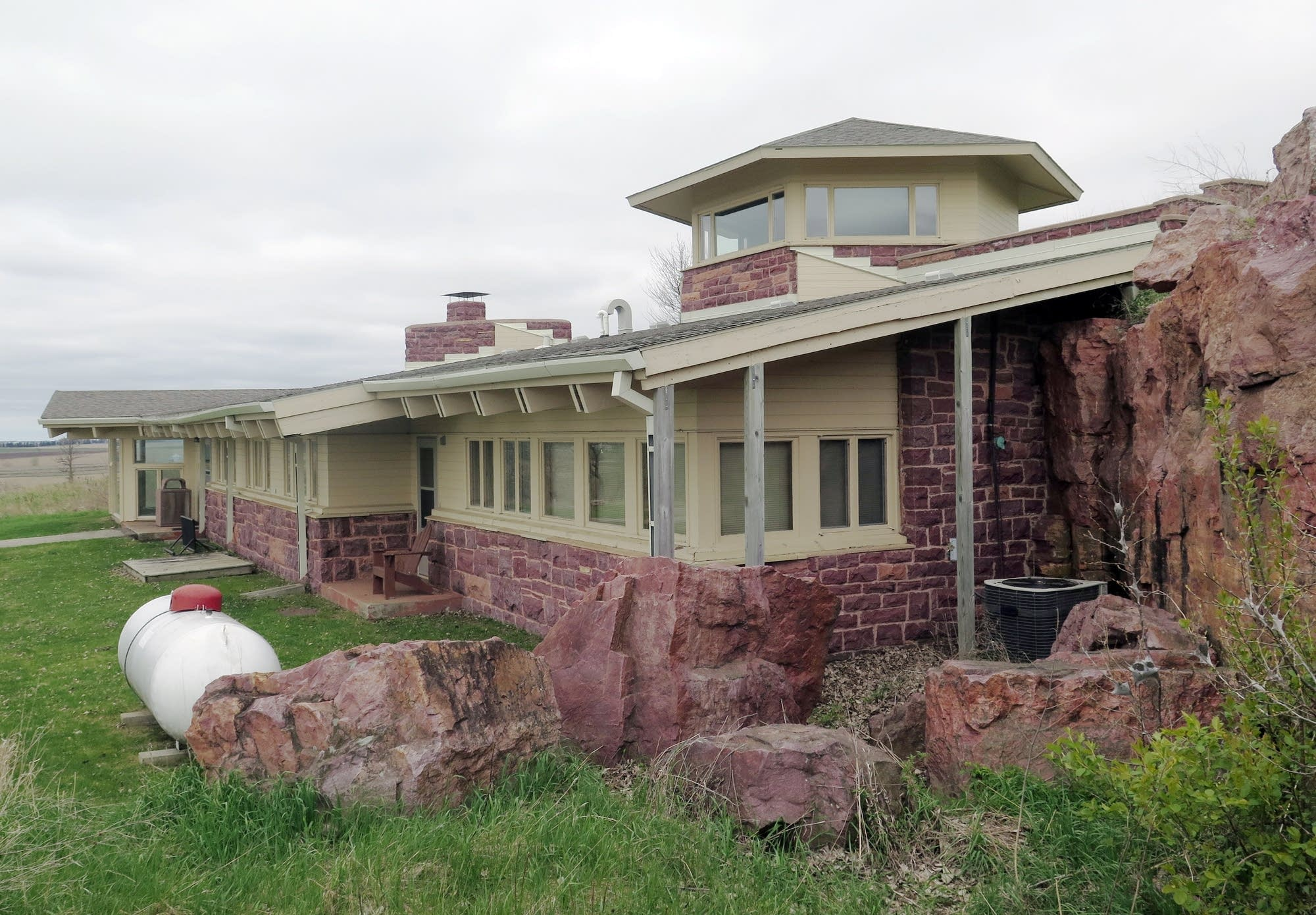 Author Frederick Manfred used a rock cliff for the back wall of the house.