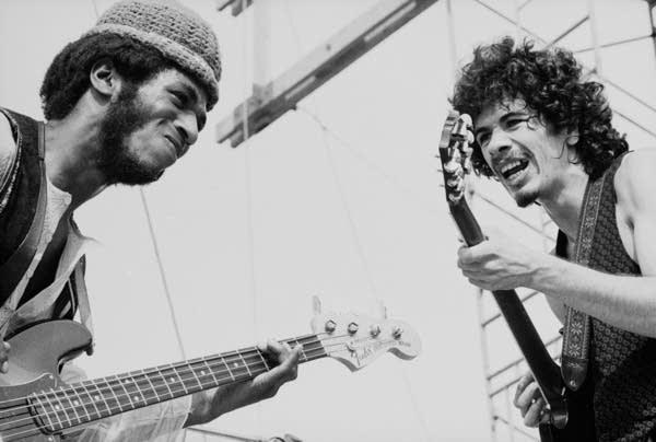David Brown and Carlos Santana perform at Woodstock in 1969.