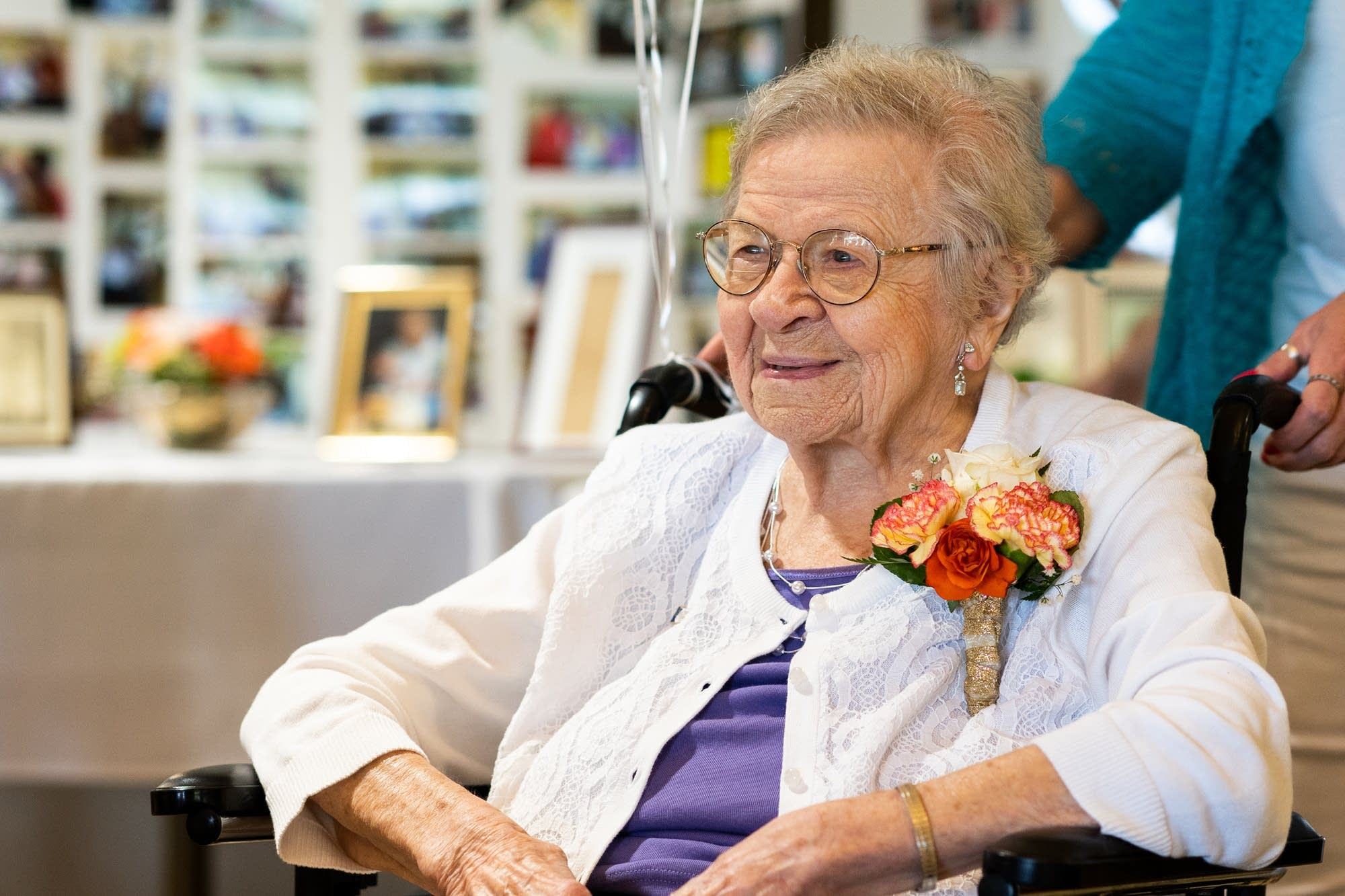 Super-centenarian Evelyn Kleine smiles at friends and family.