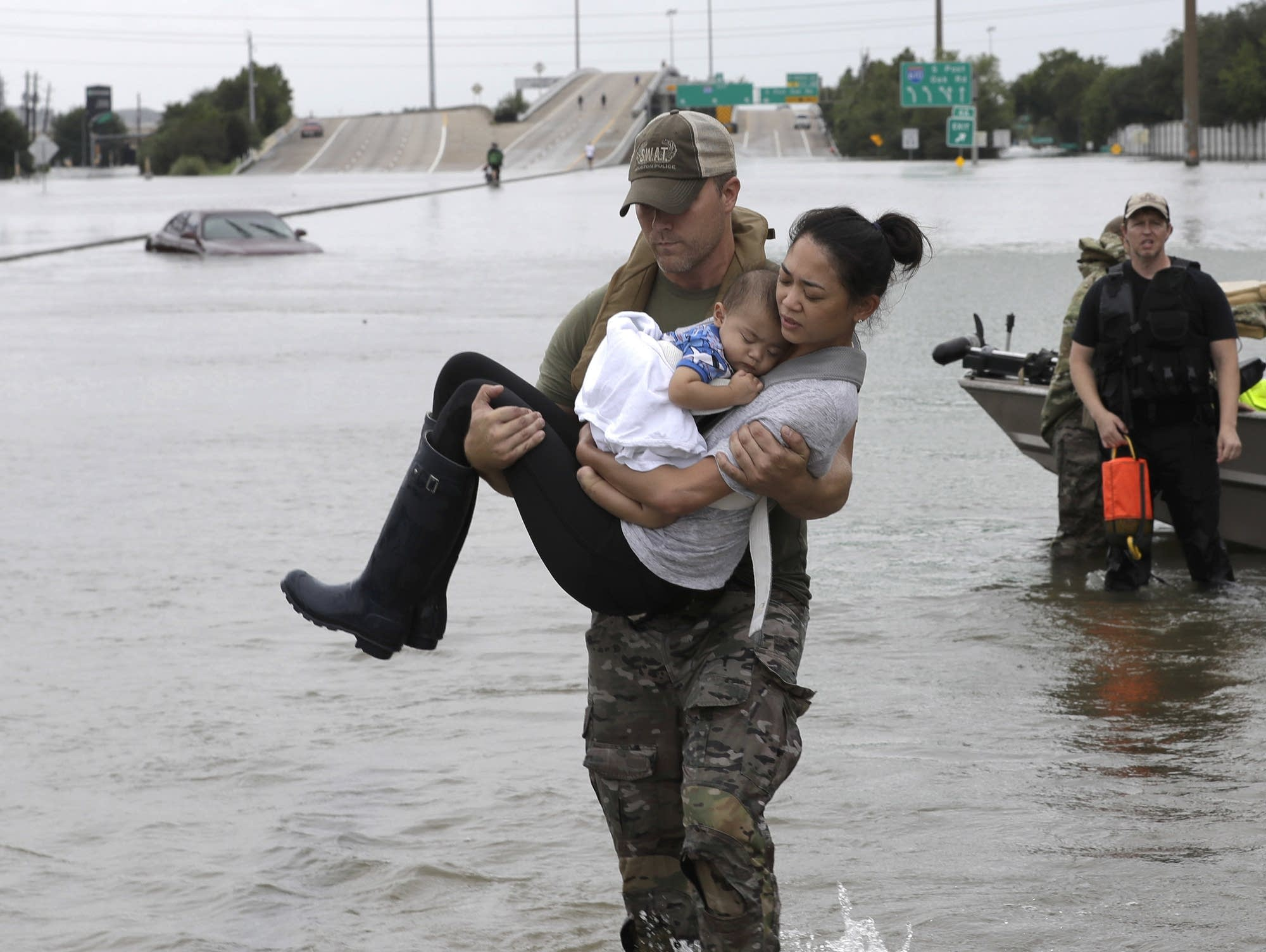 A Houston Police SWAT officer carried a woman and her son