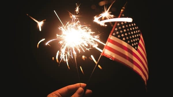 A sparkler and an American flag.