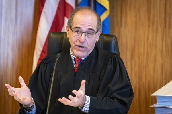 A judge presides over a hearing in the PolyMet permit case.