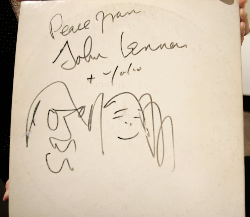 A Beatles White Album, signed and drawn on by John Lennon and Yoko Ono in 1969, is held on display at Christie's Auction House, November 21, 2005 in New York