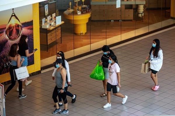 Shoppers wear face masks.