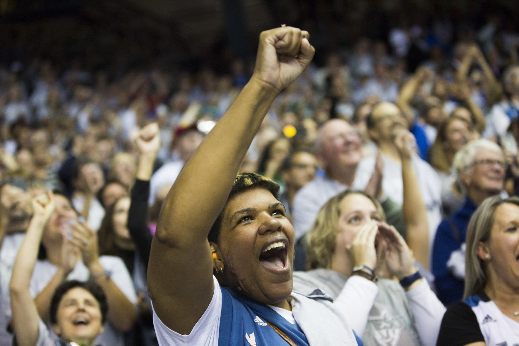 Terry McFarland and other Lynx fans celebrate their win.