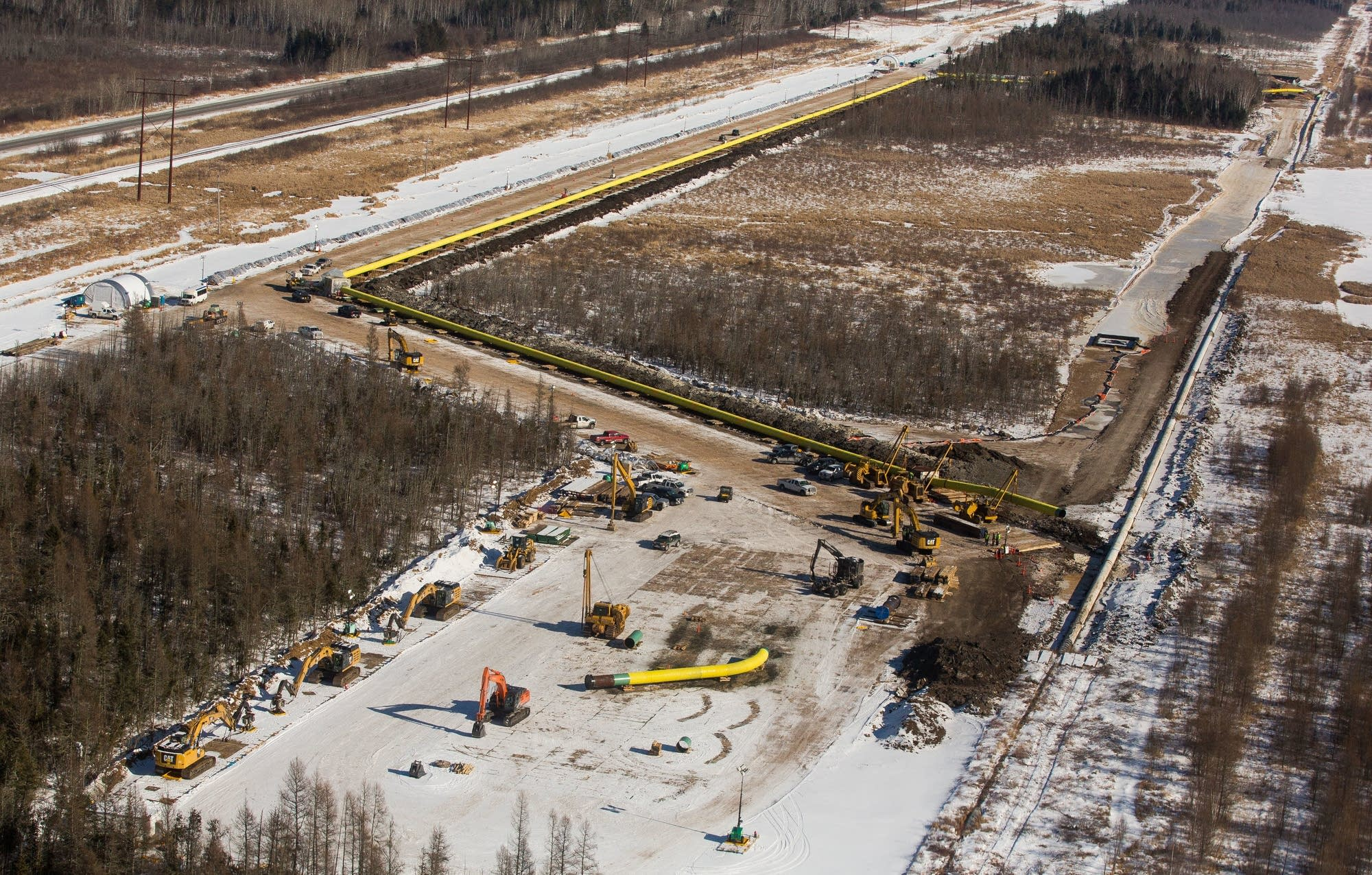 Construction crews work to replace a segment of Enbridge's Line 4.