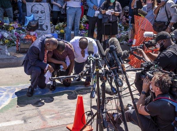 People kneeling on the ground.