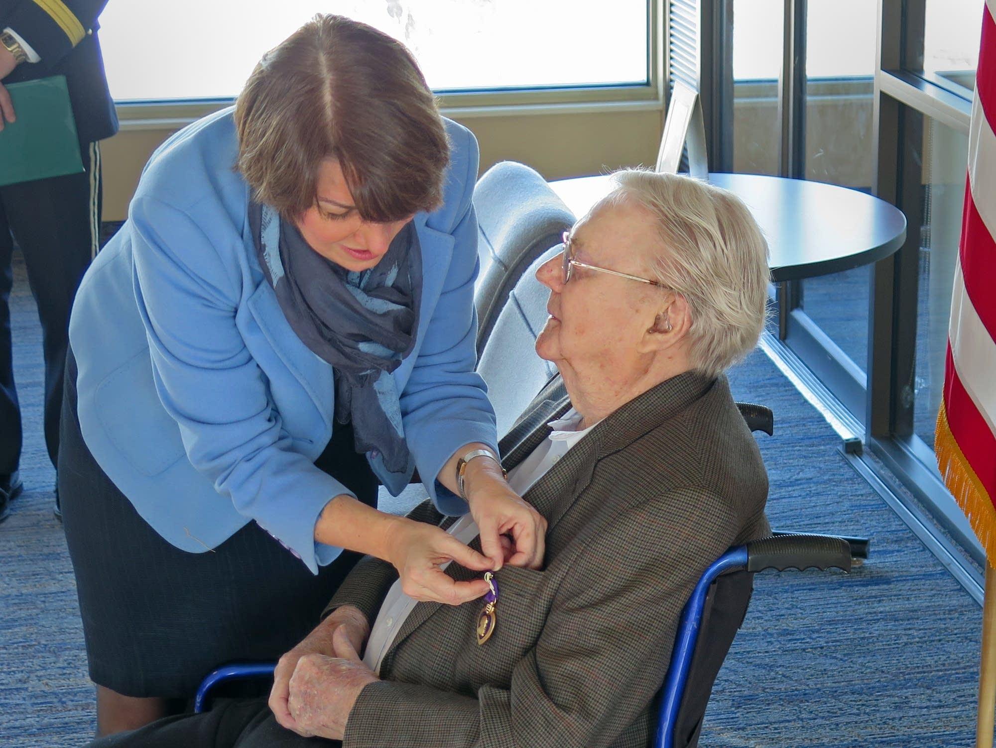 Sen. Amy Klobuchar pinned  a the Purple Heart on WWII vet Wayne Sundberg.