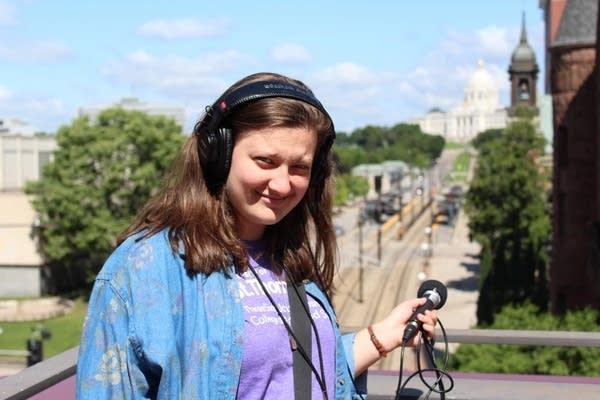 Radio Camp Reporter Josie Morss holds equipment