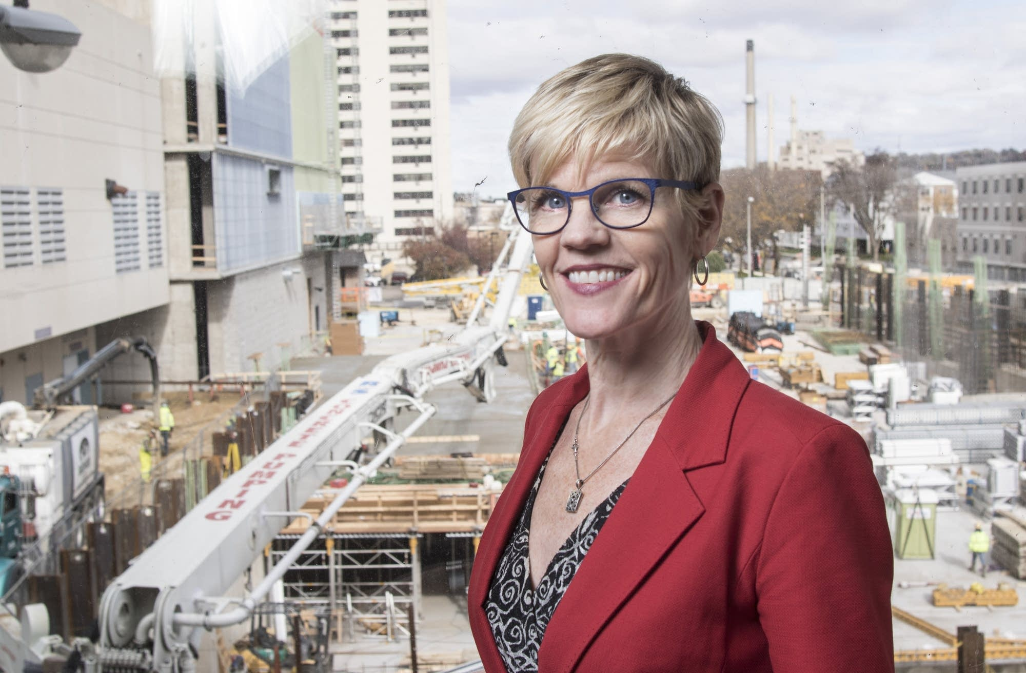 Lisa Clarke stands in a skyway overlooking Hilton Hotel construction.