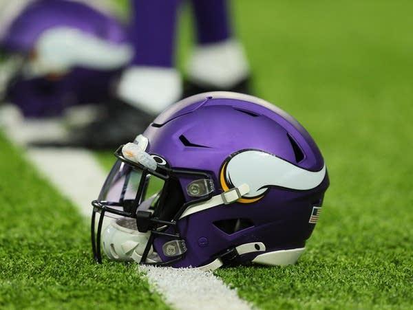 A Minnesota Vikings helmet sits on the field