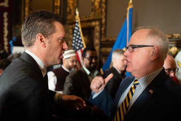 House Minority Leader Kurt Daudt and Gov. Tim Walz talk.