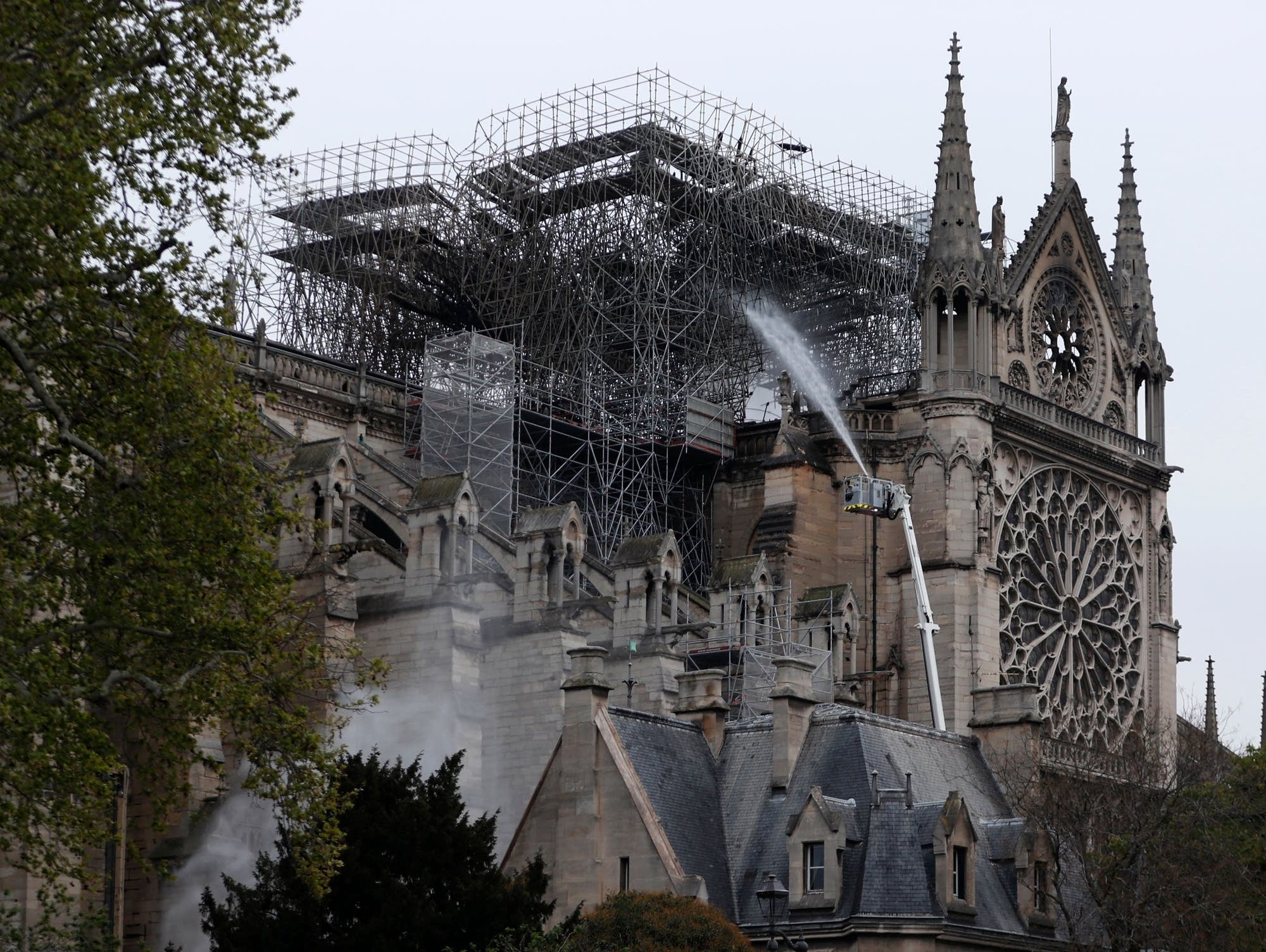 Firefighters spray water at Notre Dame Cathedral in Paris on April 16.