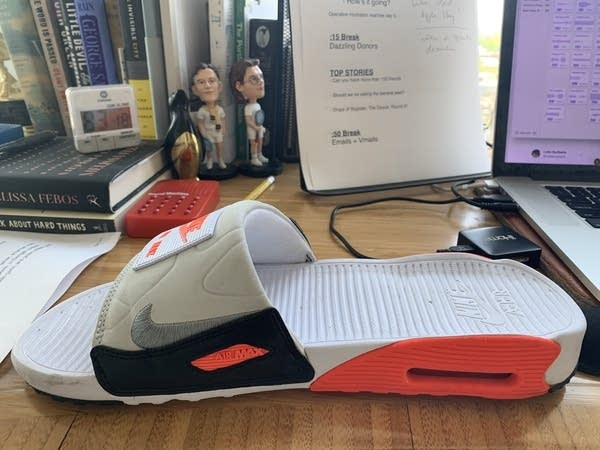 "Photo of a slip-on casual Nike sandal or flip-flop or ""slide"""