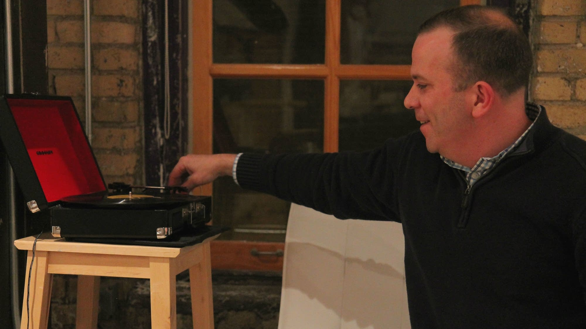 Jim O'Neill plays an LP from a vinyl collection he inherited.