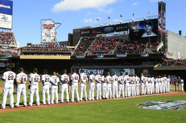 Twins players line up for opening day.