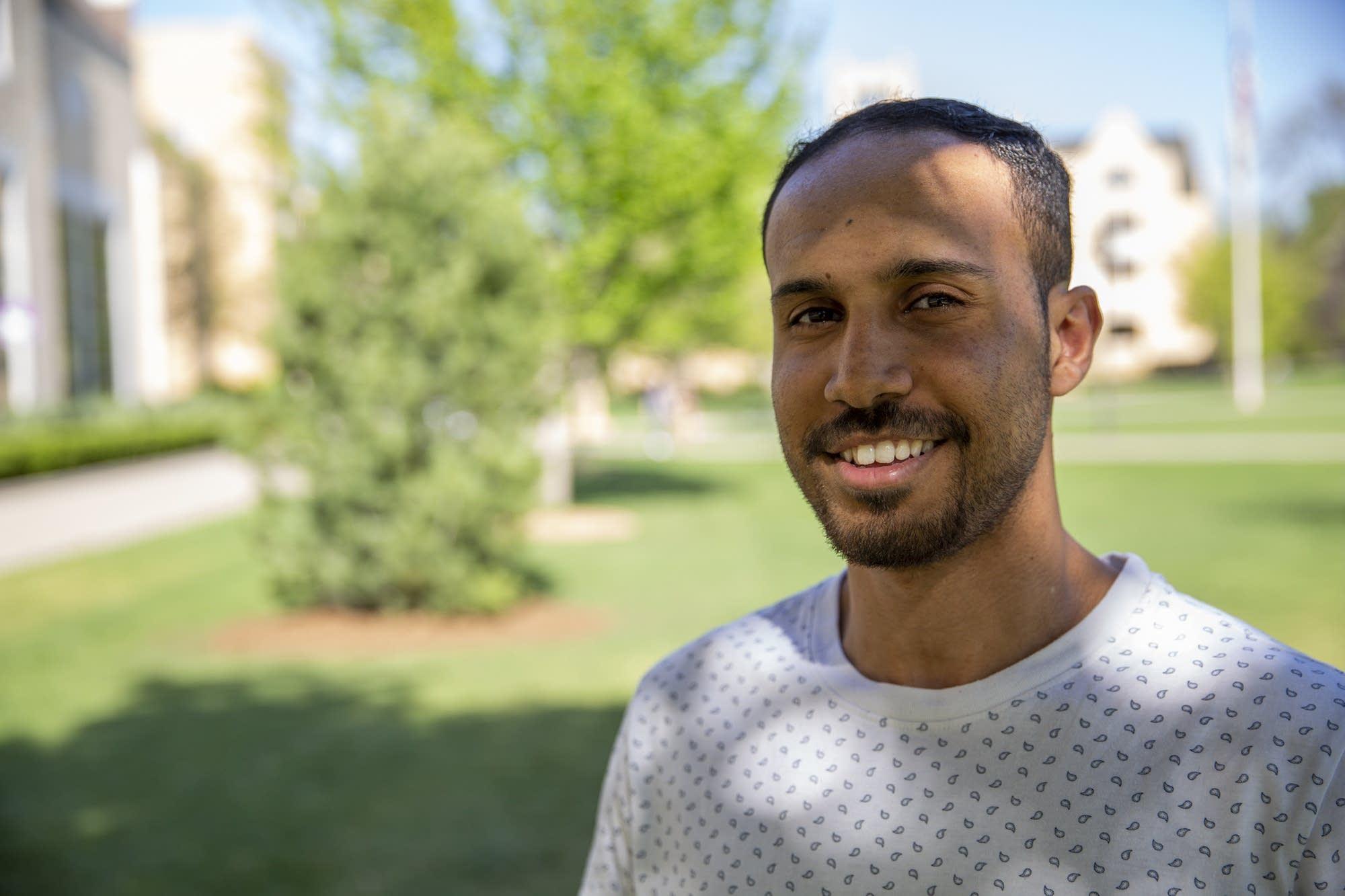 University of St. Thomas senior Mohamed Malim stands for a portrait