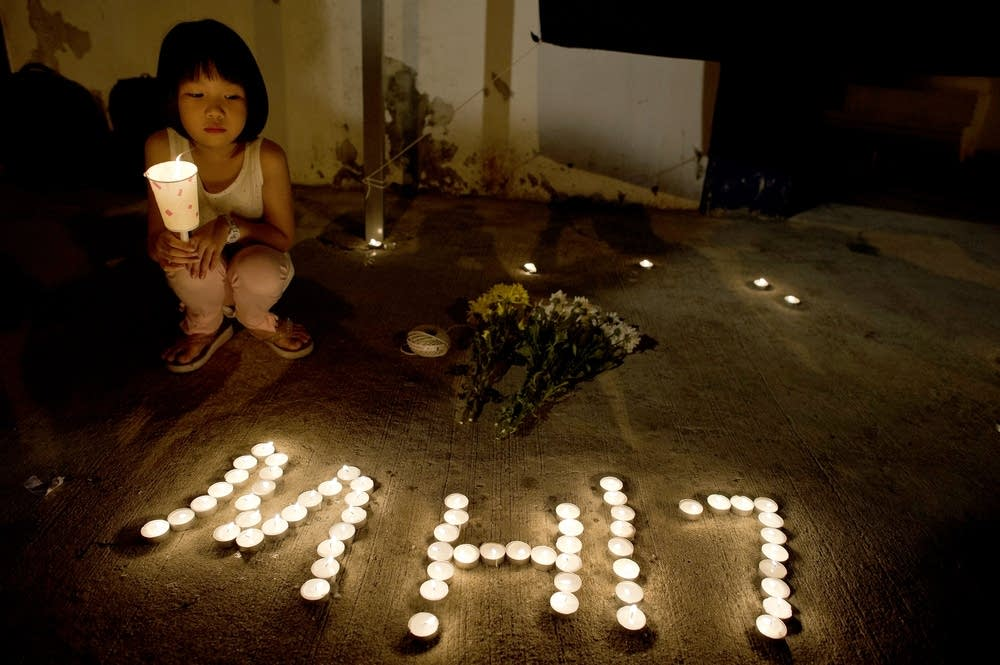 A girl holds a candle in Kuala Lumpur