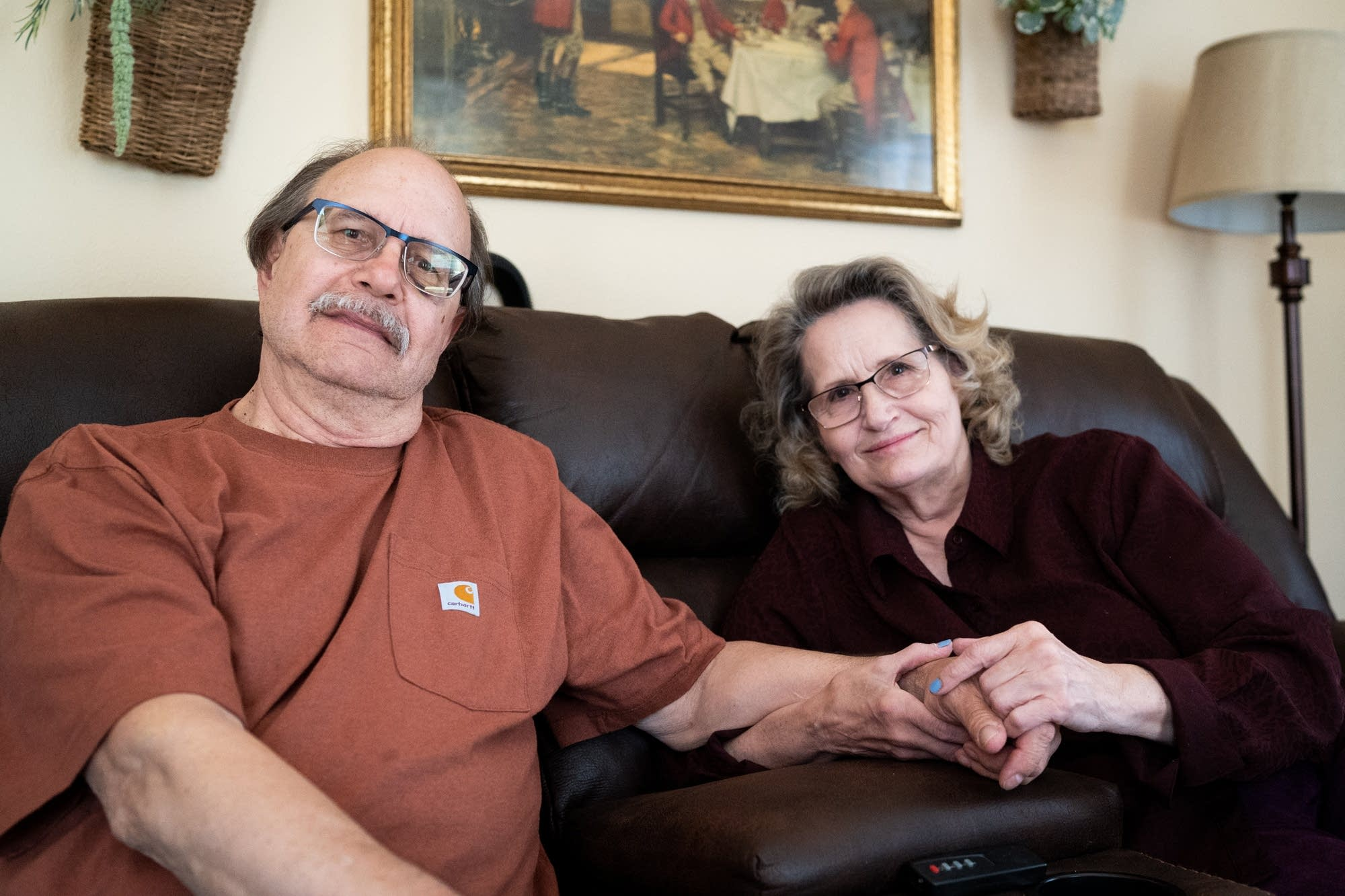 Charlie and Diane Stuns sit for a portrait in their St. Paul home