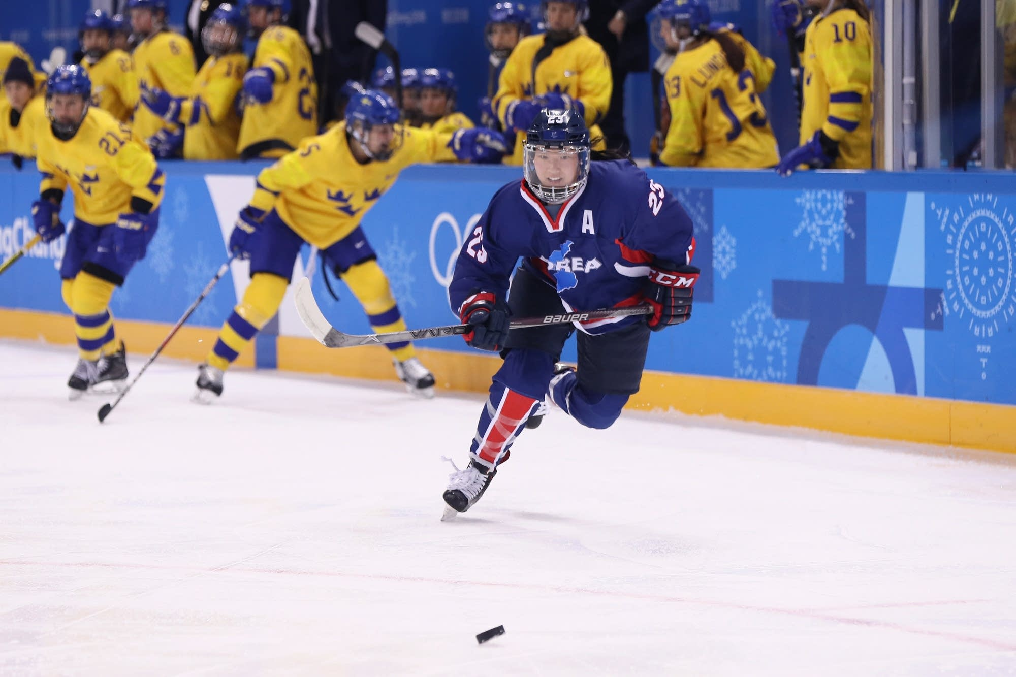 Marissa Brandt skates for the puck against Sweden