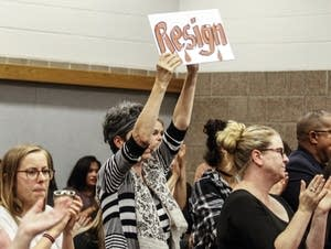 Protesters demand that St. Anthony, Minn., Mayor Jerry Faust resign.