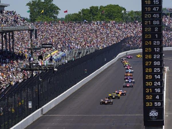 Fans watch an auto race