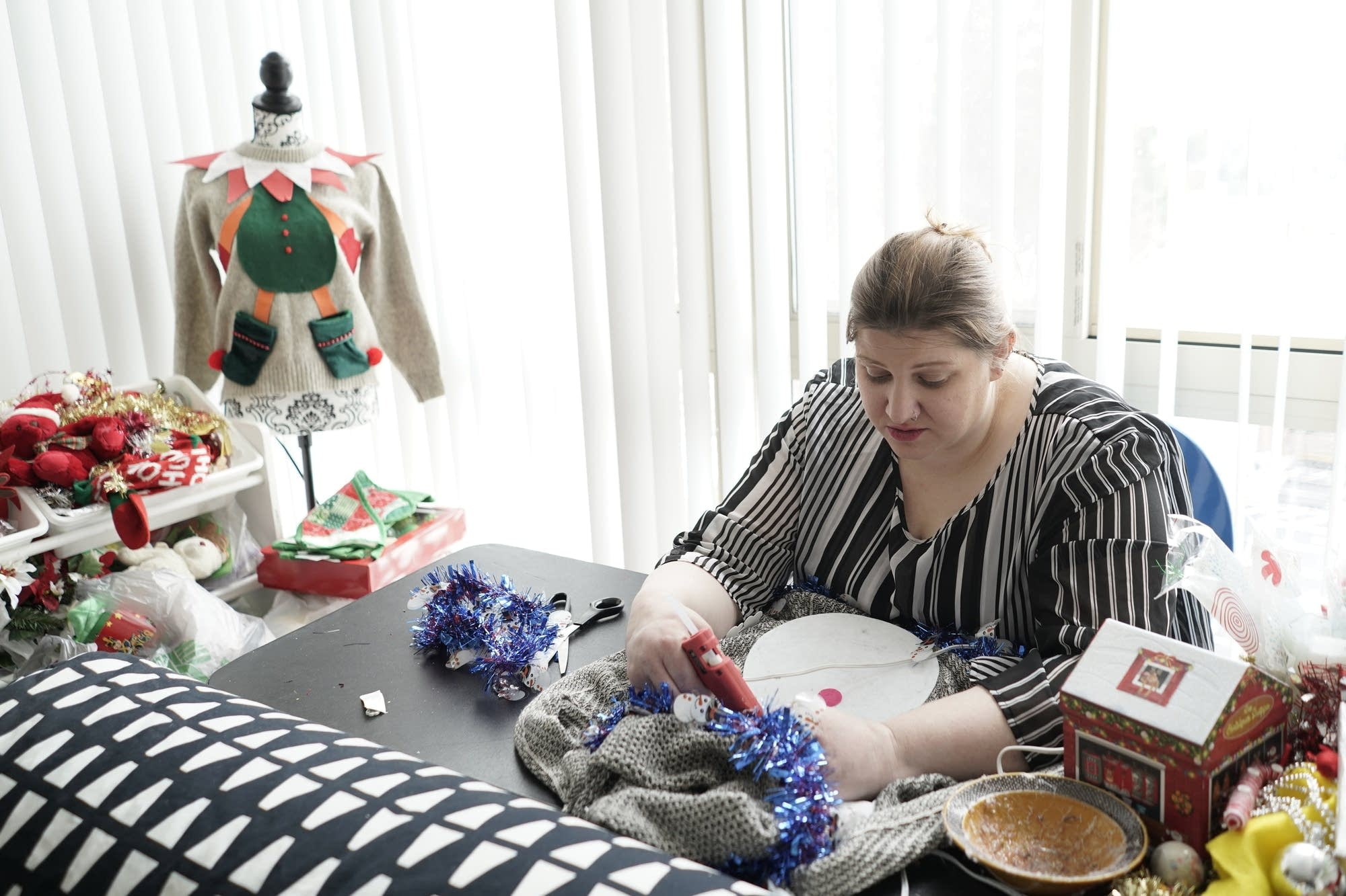 "Doris Cochran works on an ""ugly sweater."""