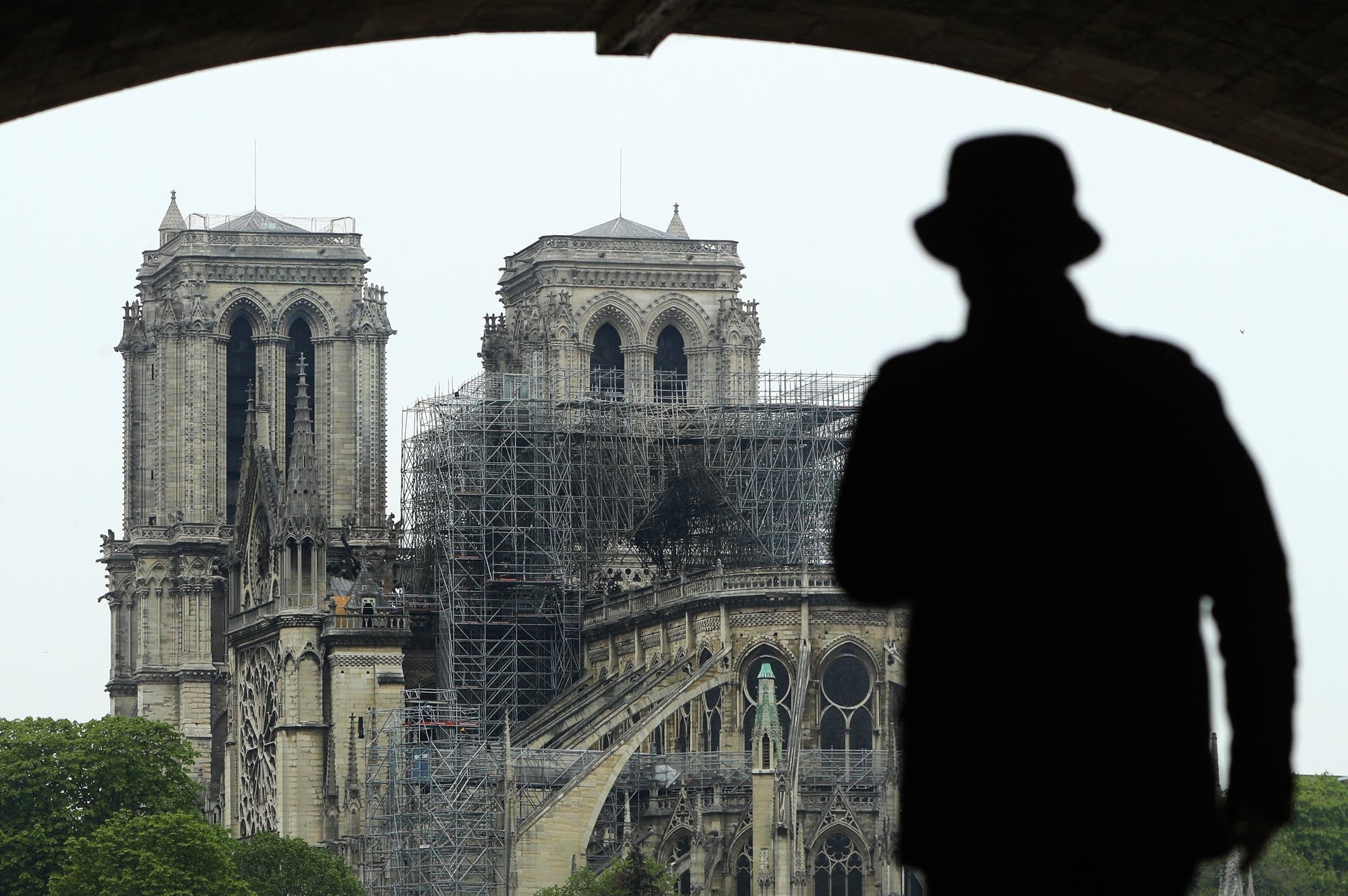 A man looks at the damage caused to the Notre Dame cathedral.